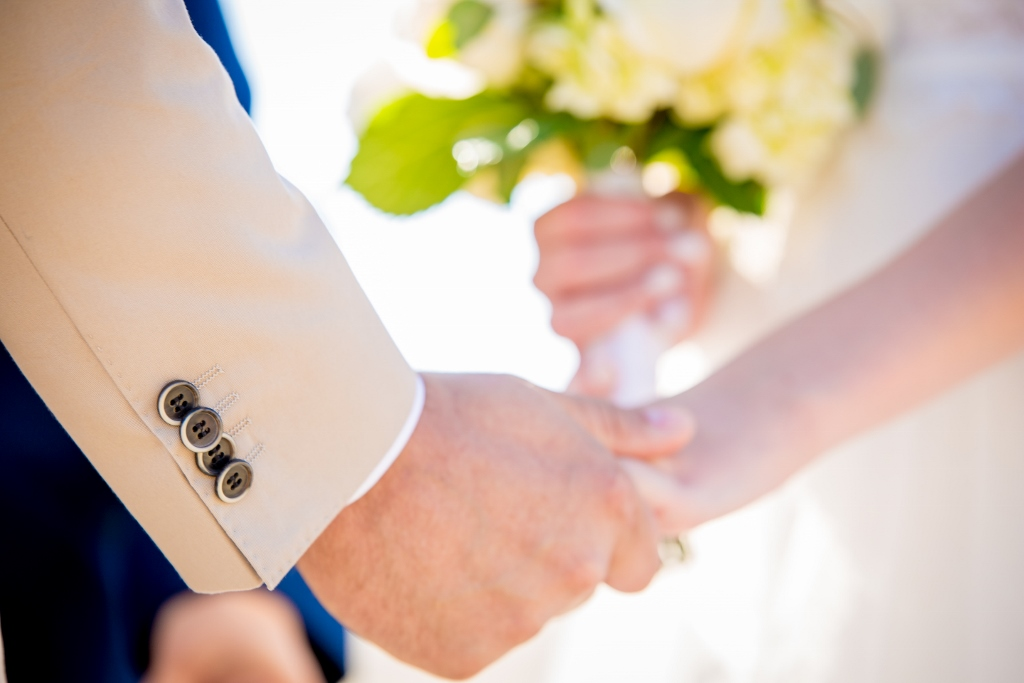 bride and groom holding hands.jpg