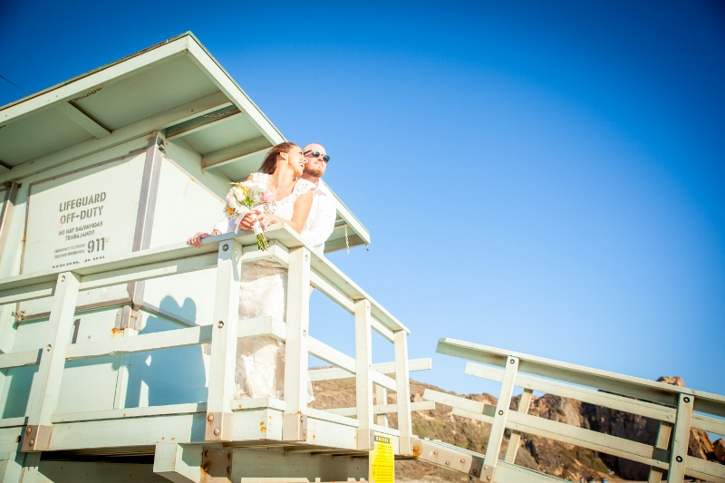 Bride and groom on lifeguard tower.jpg