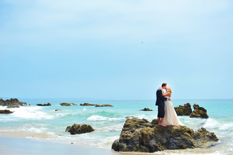 Bride and groom on the rocks at Leo Carrillo beach.jpg